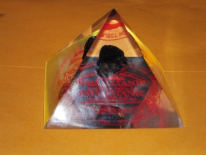picture of plastic pyramid with embeded lump of coal