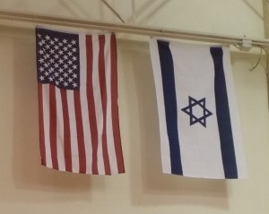 picture of US and Israel flags hanging side by side