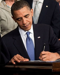 picture of Barack Obama signing legislation
